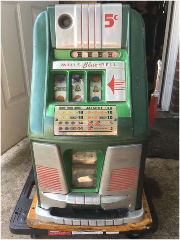 What are the things to look for when buying an Antique pokies machine